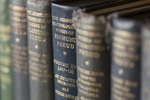 Freud books on shelf