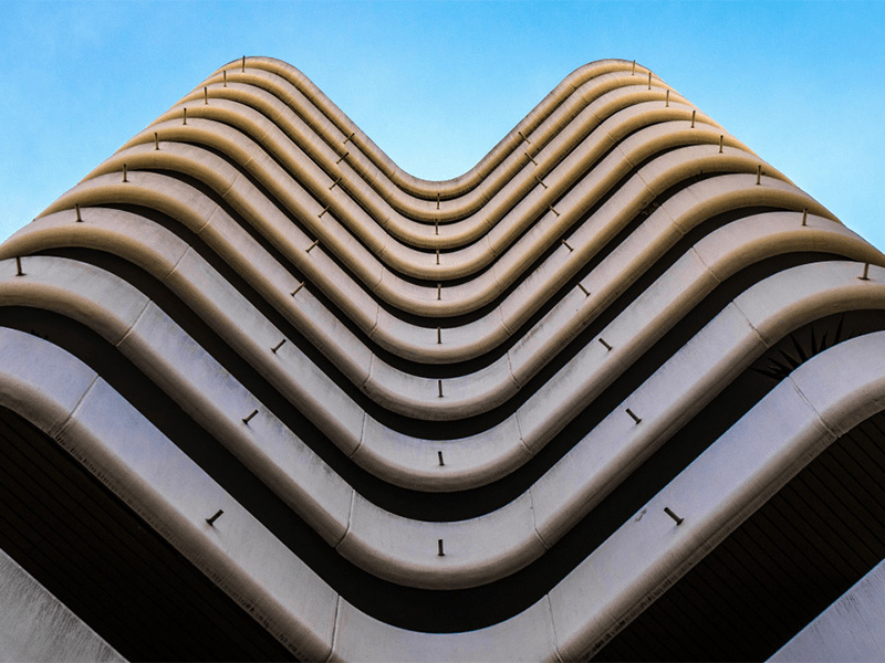 Upward shot of curved building