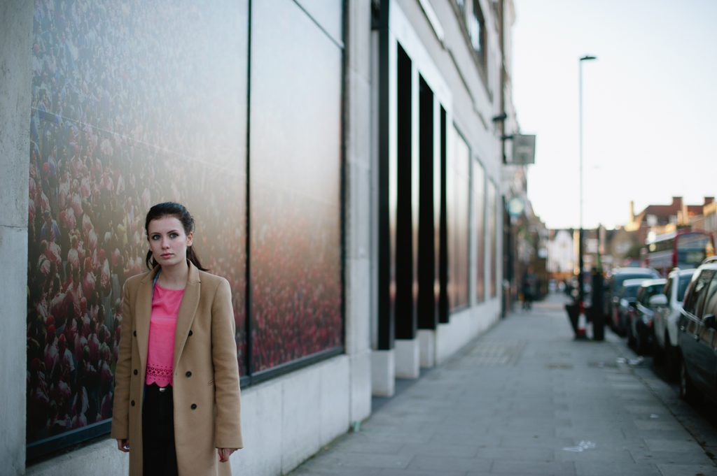 young woman standing in a street