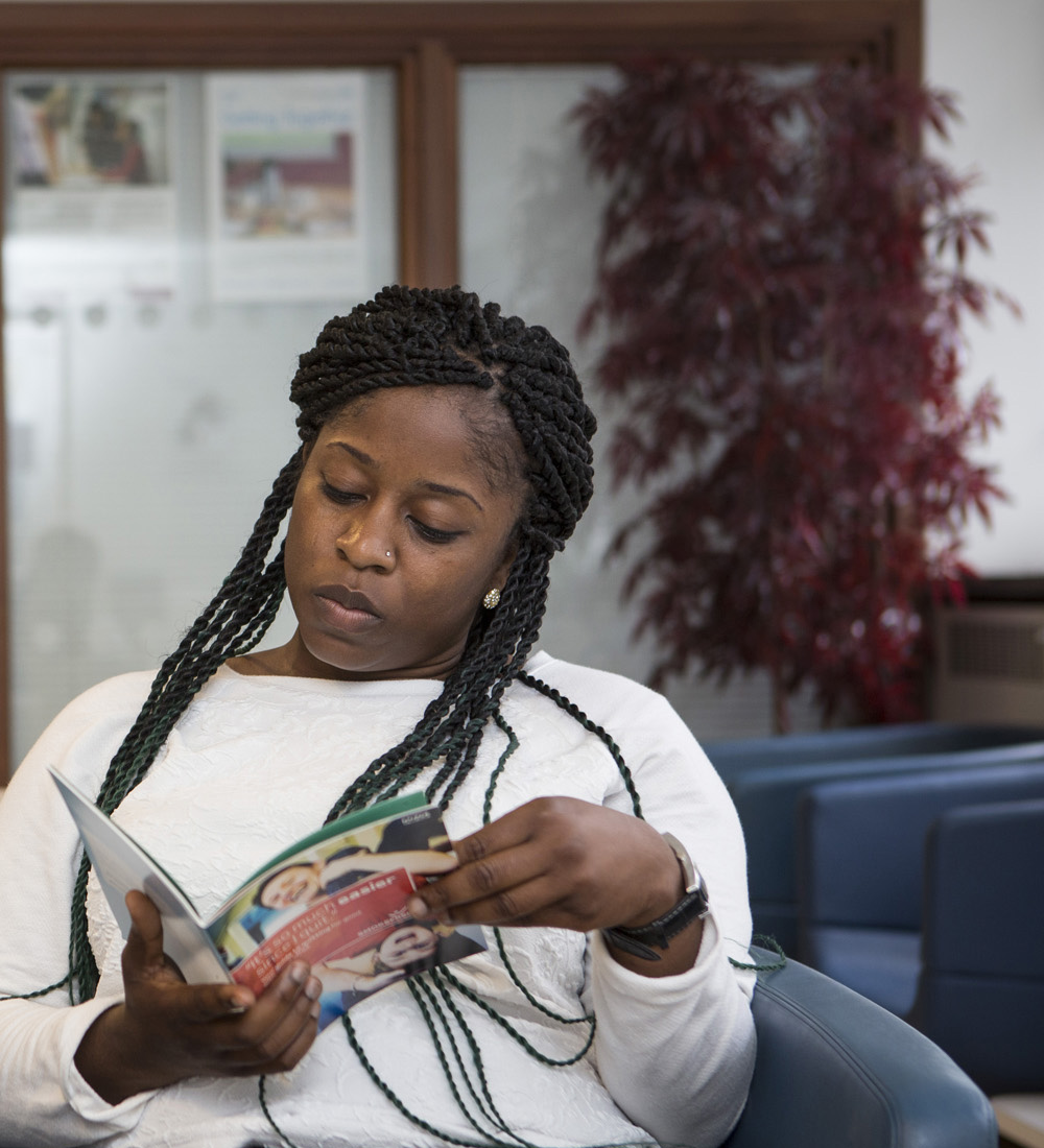 Woman reading magazine in a waiting room